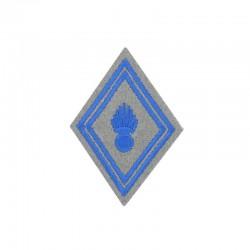 Ecusson de bras losange de troupe matériel brodé bleu ciel sur un fond gris