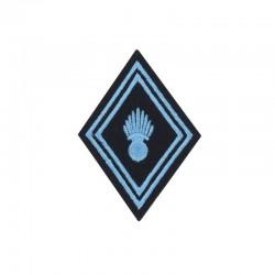 Ecusson de bras losange Troupe Transmission brodé bleu ciel sur un fond noir